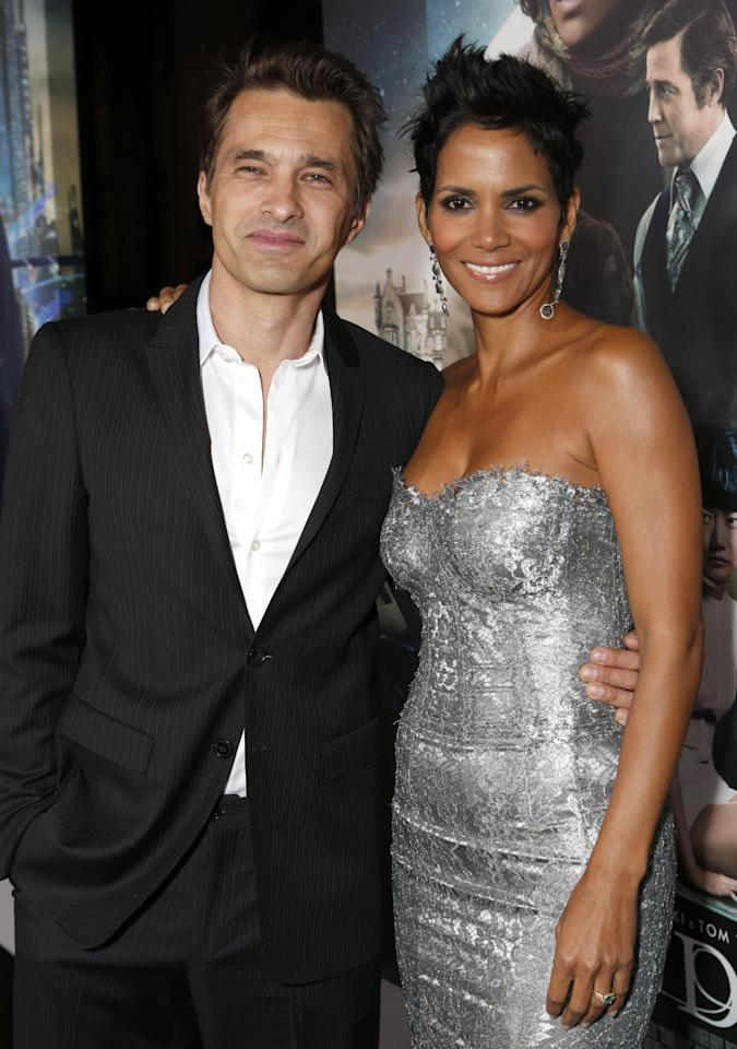 Olivier Martinez and Halle Berry arrive at the Los Angeles premiere of 'Cloud Atlas' at Grauman's Chinese Theatre on October 24, 2012 in Hollywood, California. (Photo by Todd Williamson/Invision/AP Images)