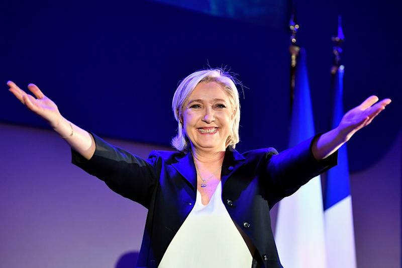 Marine Le Pen salutes her supporters as results come in: Getty