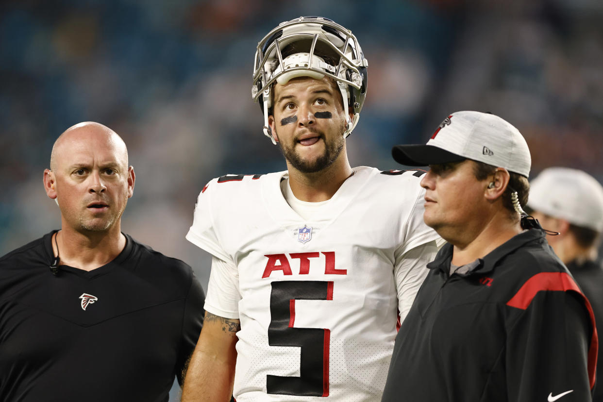 MIAMI GARDENS, FLORIDA - AUGUST 21: AJ McCarron #5 of the Atlanta Falcons reacts as he is helped off the field by trainers after being injured during a preseason game against the Miami Dolphins at Hard Rock Stadium on August 21, 2021 in Miami Gardens, Florida. (Photo by Michael Reaves/Getty Images)