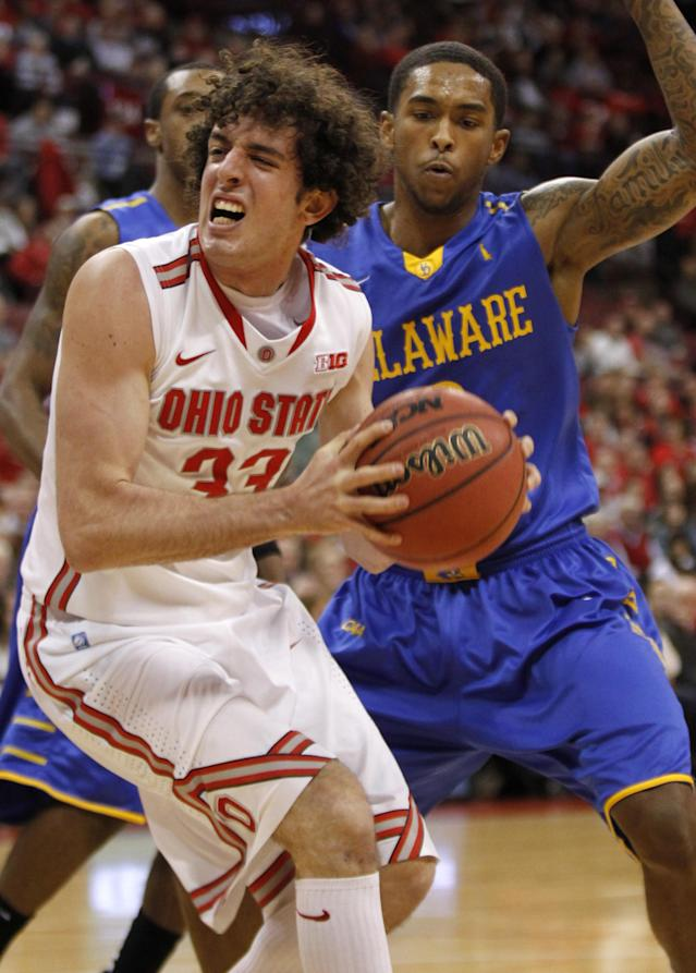 Ohio State's Amedeo Della Valle, left, works against Delaware's Davon Usher during the first half of an NCAA college basketball game in Columbus, Ohio, Wednesday, Dec. 18, 2013. Ohio State won 76-64. ( AP Photo/Paul Vernon)