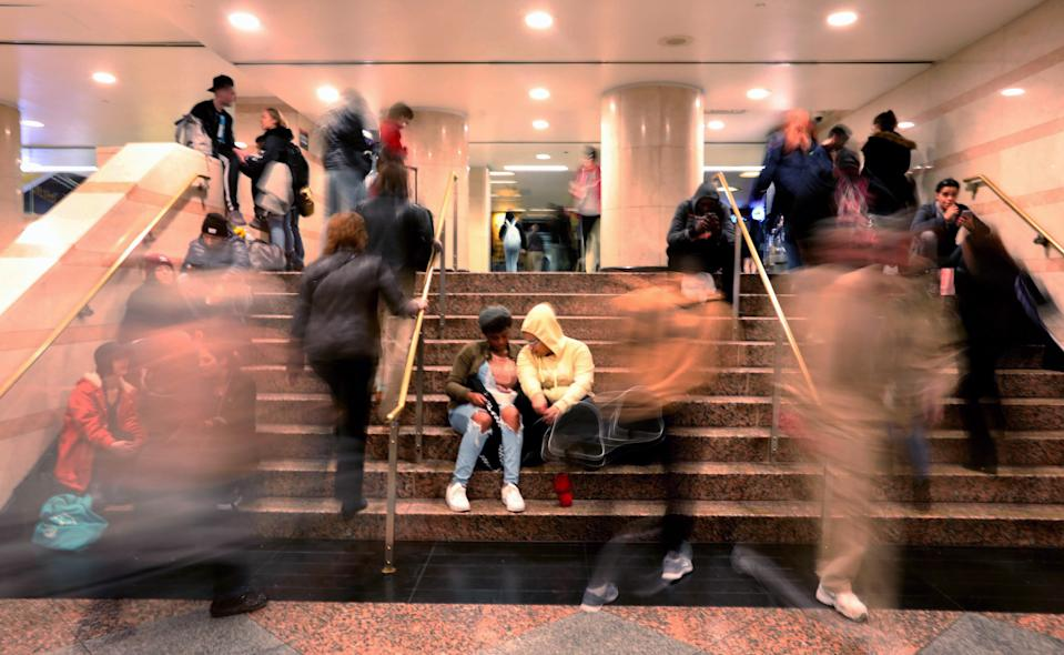 With limited seating for riders waiting for trains at Penn Station, N.J. Transit riders sit on stairways at Penn Station on a Sunday afternoon Oct. 27, 2019.