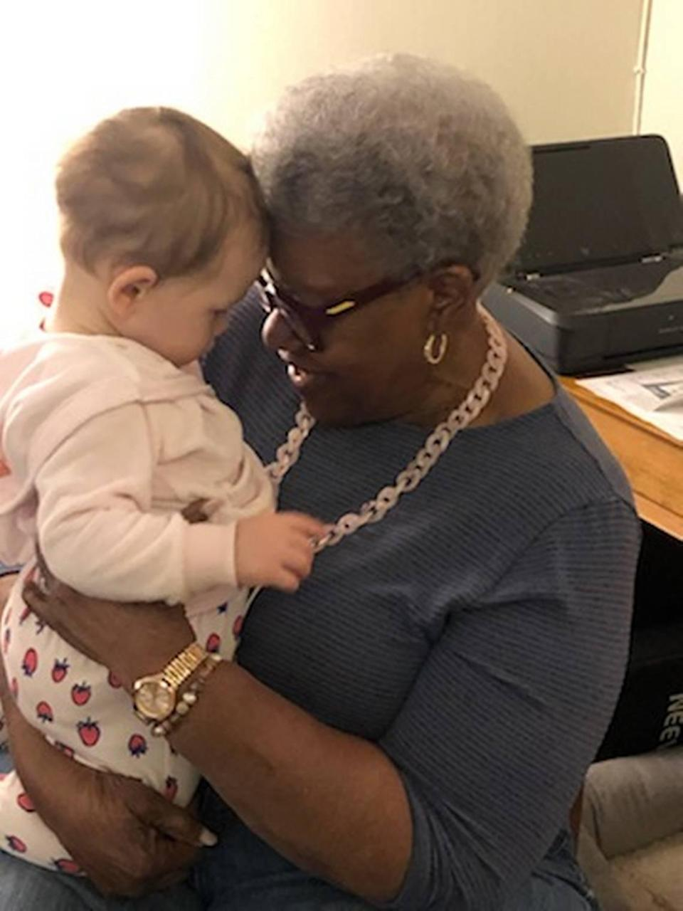 Bea Hines holding her 10-month-old great-granddaughter, Loretta Jane, for the first time on Monday, April 12, at the baby's home in New York.