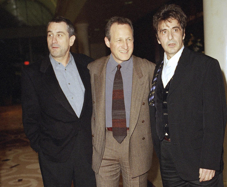 """FILE - In this Dec. 6, 1995 file photo, actors Robert De Niro, left, and Al Pacino, right, and film director Michael Mann appear at the world premiere of their film """"Heat"""" at Warner Bros. Studios in Burbank, Calif. Mann's 1995 opus of driven men and the women who suffer their obsessions comes out on Blu-ray on Tuesday. (AP Photo/Rhonda Birndorf, File)"""