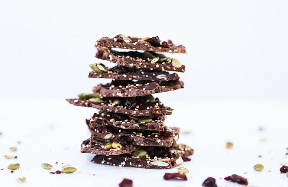 """<p>You can make this incredible cherry chocolate quinoa bark with only four ingredients. Just toast some quinoa and mix it with melted chocolate, cherries and pumpkin seeds. Spread the mixture onto parchment paper and refrigerate it for 15 minutes. This treat can be a healthy snack as well since chocolate is one of those <a href=""""https://www.thedailymeal.com/healthy-eating/blood-pressure-lowering-foods-drinks?referrer=yahoo&category=beauty_food&include_utm=1&utm_medium=referral&utm_source=yahoo&utm_campaign=feed"""" rel=""""nofollow noopener"""" target=""""_blank"""" data-ylk=""""slk:foods that help lower blood pressure"""" class=""""link rapid-noclick-resp"""">foods that help lower blood pressure</a>.</p> <p><a href=""""https://www.thedailymeal.com/best-recipes/dark-chocolate-cherry-quinoa-bark?referrer=yahoo&category=beauty_food&include_utm=1&utm_medium=referral&utm_source=yahoo&utm_campaign=feed"""" rel=""""nofollow noopener"""" target=""""_blank"""" data-ylk=""""slk:For the Dark Chocolate Cherry Quinoa Bark recipe, click here"""" class=""""link rapid-noclick-resp"""">For the Dark Chocolate Cherry Quinoa Bark recipe, click here</a>.</p>"""