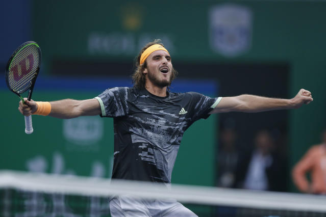 Stefanos Tsitsipas of Greece celebrates after defeating Novak Djokovic of Serbia in the men's singles quarterfinals match at the Shanghai Masters tennis tournament at Qizhong Forest Sports City Tennis Center in Shanghai, China, Friday, Oct. 11, 2019. (AP Photo/Andy Wong)