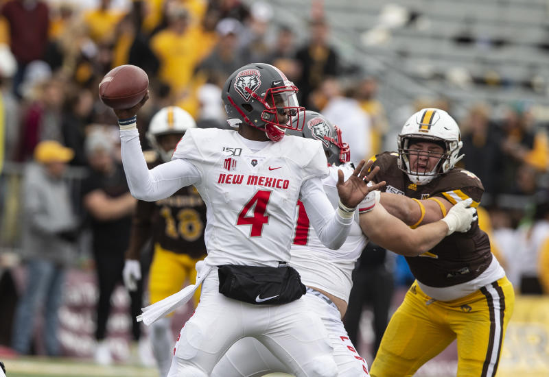 New Mexico quarterback Sheriron Jones throws a pass against Wyoming during an NCAA college football game Saturday, Oct. 19, 2019, in Laramie, Wy. (AP Photo/Michael Smith)