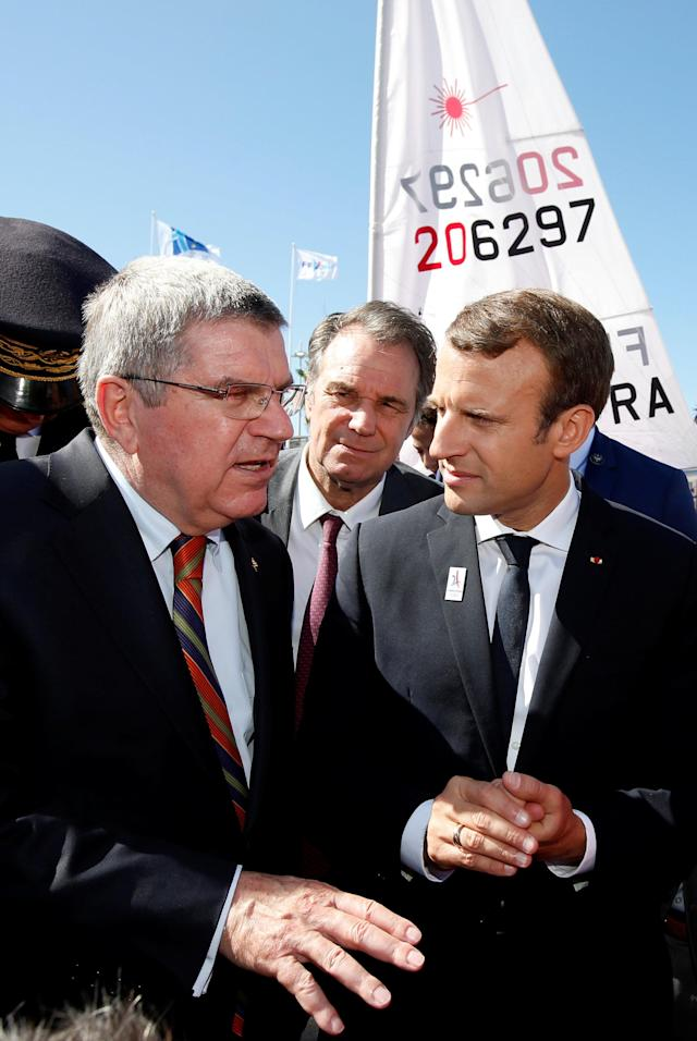 "French President Emmanuel Macron (R) and International Olympic Committee (IOC) President Thomas Bach (L) visit the site of the future Olympic Sailing venue (Voile Olympique) at the ""Marina Olympique"" nautical base in Marseille, France, after the decision for Paris to host of the 2024 Summer Olympics Games, September 21, 2017. REUTERS/Jean-Paul Pelissier"