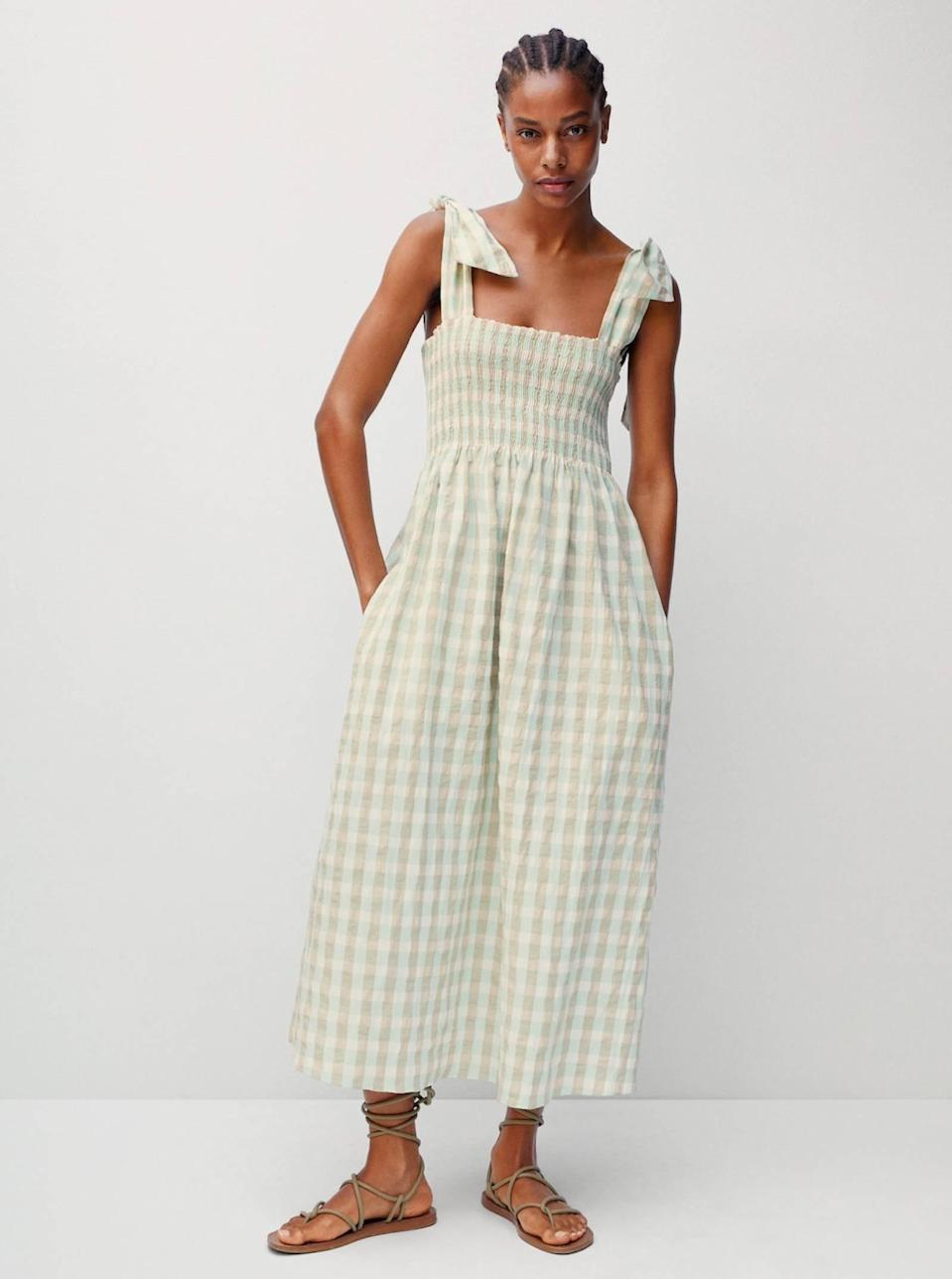 """Speaking of picnics, don't be afraid to go matchy-matchy with the blanket. Gingham and checkerboard are here to stay (at least for the season), and this Mango price is right. $80, Mango. <a href=""""https://shop.mango.com/us/women/dresses-and-jumpsuits-midi/vichy-check-dress_87007152.html"""" rel=""""nofollow noopener"""" target=""""_blank"""" data-ylk=""""slk:Get it now!"""" class=""""link rapid-noclick-resp"""">Get it now!</a>"""