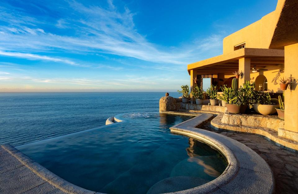 """<p>One look at this spacious <a href=""""https://www.cntraveler.com/stories/2016-05-13/top-things-to-do-in-los-cabos-mexico?mbid=synd_yahoo_rss"""" rel=""""nofollow noopener"""" target=""""_blank"""" data-ylk=""""slk:Cabo San Lucas"""" class=""""link rapid-noclick-resp"""">Cabo San Lucas</a> home—12 guests can sleep across six bedrooms—is enough to make us want to plan a <a href=""""https://www.cntraveler.com/gallery/best-airbnbs-for-family-reunions?mbid=synd_yahoo_rss"""" rel=""""nofollow noopener"""" target=""""_blank"""" data-ylk=""""slk:family reunion"""" class=""""link rapid-noclick-resp"""">family reunion</a>. It almost doesn't matter what's inside: you'll want to spend all your time in the backyard, dining al fresco, and taking dips in the pool, which overlooks Lands End. The inside more than measures up, though, with a U-shaped dining room with wrap-around windows, bedrooms that open up onto the patio, and a master bath as big as a studio apartment. And while the nightly cost is steep, a stay comes with resort-like perks including a $300 Cabo Expeditions credit and a free airport to villa transfer.</p> <p><strong>Book now:</strong> <a href=""""https://airbnb.pvxt.net/2v7ka"""" rel=""""nofollow noopener"""" target=""""_blank"""" data-ylk=""""slk:From $1,680 per night, airbnb.com"""" class=""""link rapid-noclick-resp"""">From $1,680 per night, airbnb.com</a></p>"""