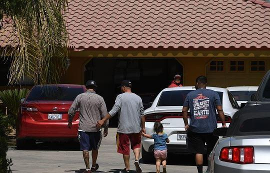 Relatives arrive at a Bakersfield home, where the last bodies were found in a shooting spree.