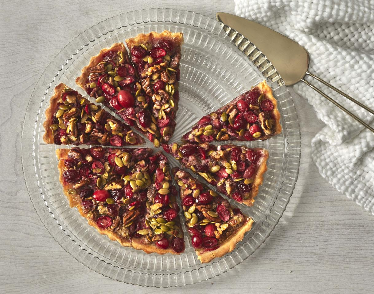 """<p><strong>Try this recipe: </strong><a href=""""https://www.health.com/recipes/gluten-free-pecan-pepita-cranberry-tart"""">Gluten-Free Pecan-Pepita-Cranberry Tart</a></p> <p>Cranberry and pumpkin seeds just scream fall, which will make this tart a new star in your end-of-the-year dessert repertoire. </p> <p><strong>Ingredients:</strong> gluten-free flour blend, granulated sugar, kosher salt, cranberries, honey, pecans, pumpkin seeds, unsalted butter, eggs, vanilla extract</p> <p><strong>Calories:</strong> 286</p>"""