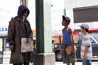 """This photo released by Lions Gate Entertainment, Inc. shows, from left, Jeffrey Wright as Henry, Skylan Brooks, as Mister and Ethan Dizon as Pete in a scene from the film, """"The Inevitable Defeat of Mister & Pete."""" Starring alongside Jennifer Hudson, Anthony Mackie, Wright and Jordin Sparks, the young actors offer moving portrayals of Mister and Pete, two boys forsaken by their drug addict mothers and left to fend for themselves through a sweltering summer. The film releases in theaters, Friday, Oct. 11, 2013. (AP Photo/Copyright Lions Gate Entertainment, Inc.)"""