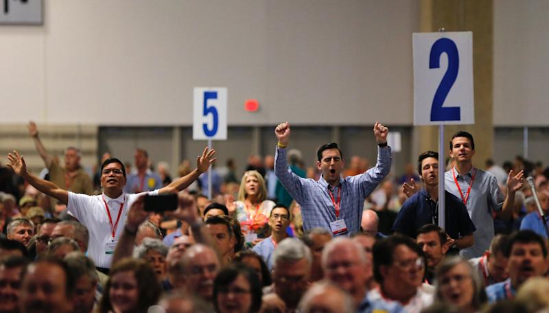 Messengers pray and worship on Tuesday, June 12, 2018, at the 2018 annual meeting of the Southern Baptist Convention in Dallas, Texas. (Fort Worth Star-Telegram via Getty Images)