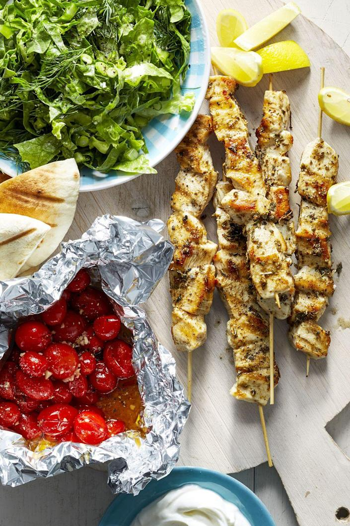 """<p>We're making #MediterraneanMonday a thing with these grilled chicken kebabs and garlicky tomatoes.</p><p><a href=""""https://www.goodhousekeeping.com/food-recipes/easy/a45192/chicken-souvlaki-skewers-recipe/"""" rel=""""nofollow noopener"""" target=""""_blank"""" data-ylk=""""slk:Get the recipe for Chicken Souvlaki Skewers »"""" class=""""link rapid-noclick-resp""""><em>Get the recipe for Chicken Souvlaki Skewers »</em></a></p>"""