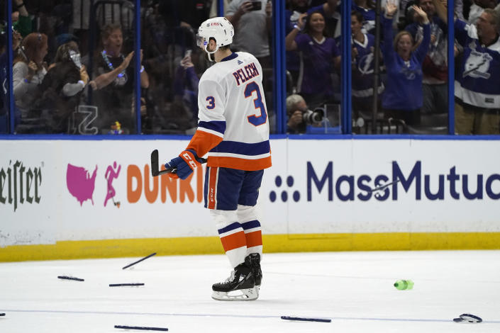 A dejected New York Islanders defenseman Adam Pelech (3) skates off the ice after losing to the Tampa Bay Lightning in Game 7 of an NHL hockey Stanley Cup semifinal playoff series Friday, June 25, 2021, in Tampa, Fla. (AP Photo/Chris O'Meara)