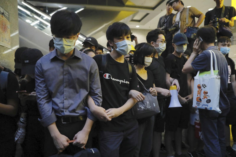 Protesters block the lobby of the Hong Kong Revenue Tower in Hong Kong on Monday, June 24, 2019. Hong Kong has been rocked by major protests for the past two weeks over legislative proposals that many view as eroding the territory's judicial independence and, more broadly, as a sign of Chinese government efforts to chip away at the city's freedoms. (AP Photo/Kin Cheung)