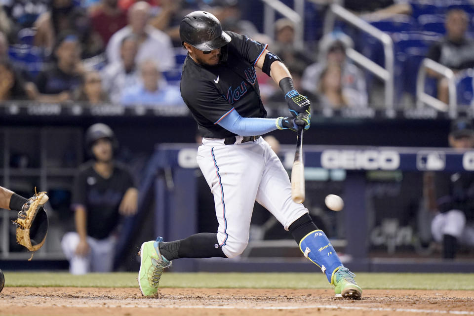 Miami Marlins' Miguel Rojas hits a single during the fifth inning of a baseball game against the San Diego Padres, Saturday, July 24, 2021, in Miami. (AP Photo/Lynne Sladky)
