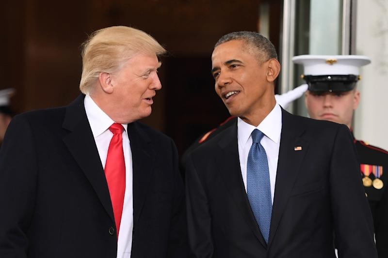 Barack Obama (right) and Donald Trump frequently traded barbs on the campaign trail (AFP Photo/JIM WATSON )