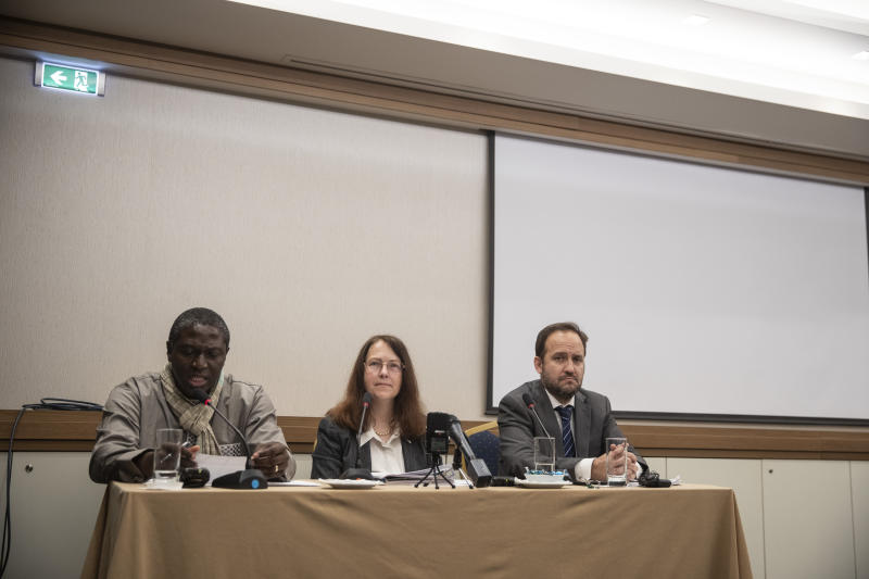 From left to right, United Nation Working group staff on Arbitrary Detention , Setondji Ronald Advovi, Leigh Toomey, and Jose Antonio Guevara Bermudez take part in a news conference in Athens, Friday, Dec. 13, 2019. A preliminary report issued by the working group after a visit to Greece found that although some improvements had been made, Greece was still violation of certain international obligations concerning detention, both in the criminal justice system and concerning migration. (AP Photo/Petros Giannakouris)