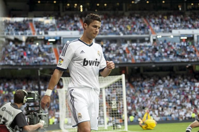Real Madrid's Portuguese forward Cristiano Ronaldo celebrates his first goal  on September 2, 2012 during a Spanish Liga football match against Granada at the Santiago Bernabeu stadium in Madrid.  AFP PHOTO/ DANI POZO