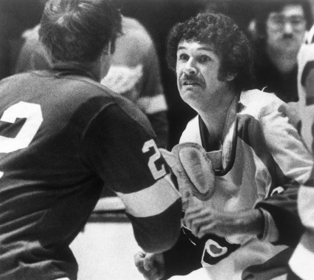 "FILE - In this March 6, 1976 file photo, Detroit Red Wings Dennis Hextall, left, and Flyers Dave Schultz, right, drop their gloves and square off during a second period fight, in Philadelphia. Both players received a game misconduct penalty for fighting. Schultz was the intimidating backbone of Philadelphia's famed ""Broad Street Bullies"" teams in the 1970's. Fighting in the NHL is down to its final rounds as the old school enforcer role fades away from game. (AP Photo/Rusty Kennedy, File)"