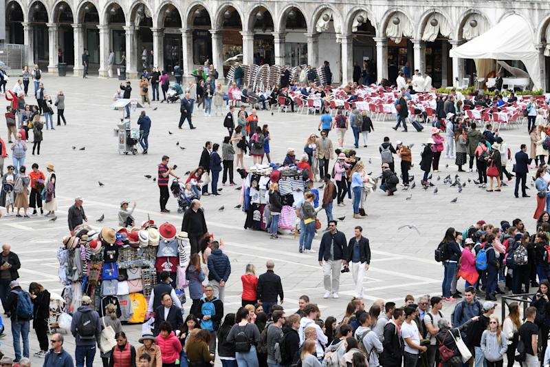 08 May 2019, Italy, Venedig: In the time of the pre-opening of the Art Biennale Venice 2019 tourists walk across St. Mark's Square. The international art exhibition starts on 11.05.2019 and ends on 24.11.2019. Photo: Felix Hörhager/dpa (Photo by Felix Hörhager/picture alliance via Getty Images)