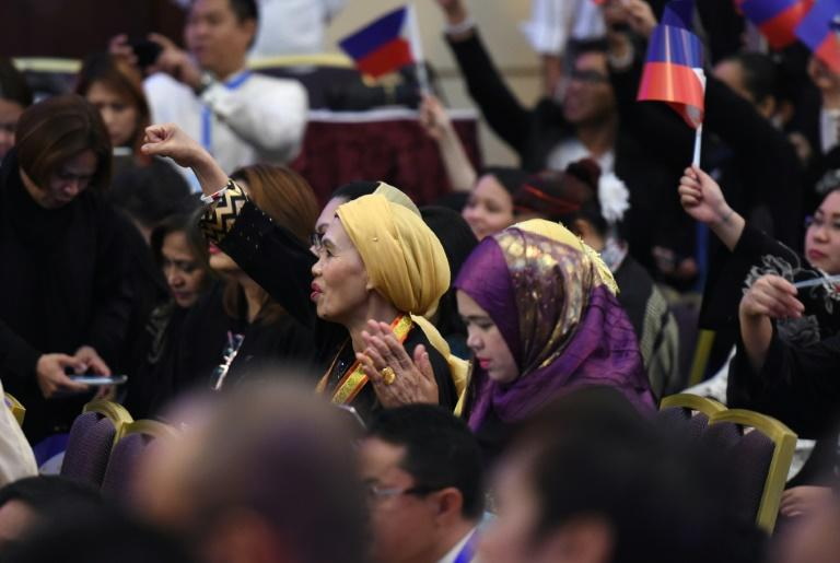 Members of the Filipino community attend a meeting with Philippine President Rodrigo Duterte in the Saudi capital Riyadh, on April 12, 2017