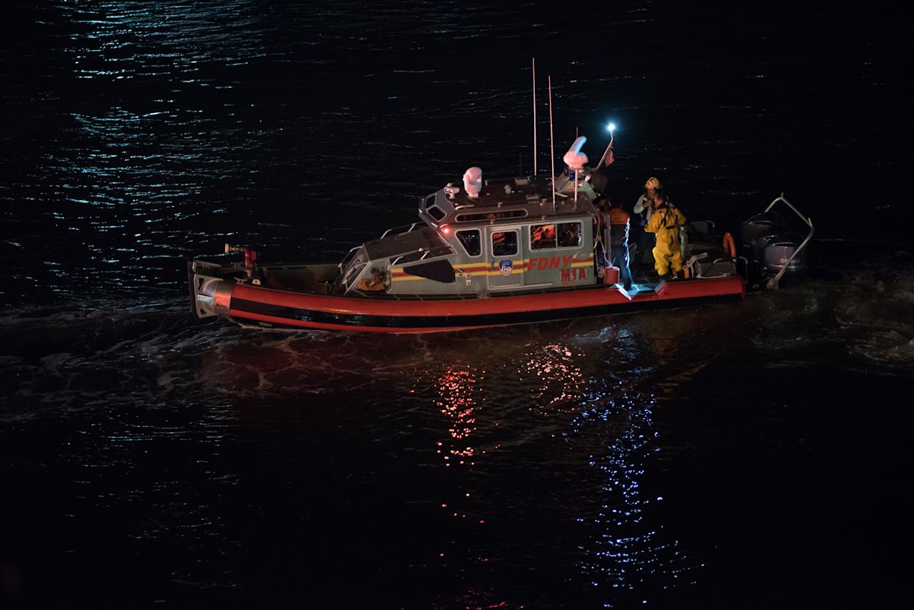 <p>New York Fire Department boat conducts a search and rescue operation after a helicopter crashed into New York City's East River on March 12, 2018. (Photo: Michael Potash/Anadolu Agency/Getty Images) </p>