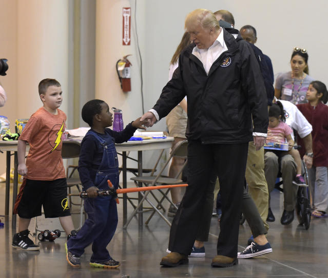 <p>President Donald Trump meets people impacted by Hurricane Harvey during a visit to the NRG Center in Houston, Saturday, Sept. 2, 2017. (Photo: Susan Walsh/AP) </p>