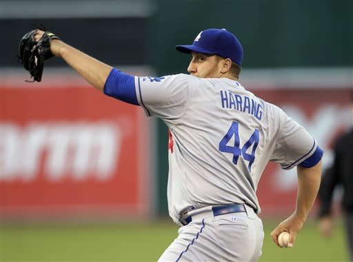 Los Angeles Dodgers starting pitcher Aaron Harang throws against the Oakland Athletics during the first inning of their baseball game in Oakland, Calif., Tuesday, June 19, 2012. (AP Photo/Eric Risberg)
