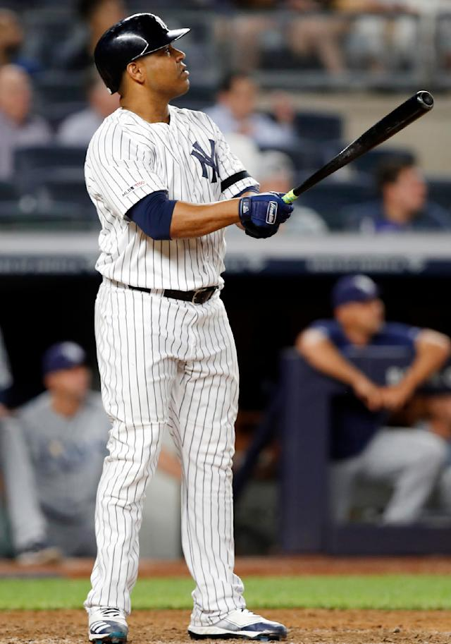 New York Yankees' Edwin Encarnacion watches his two-run home run during the eighth inning of a baseball game against the Tampa Bay Rays, Monday, July 15, 2019, in New York. (AP Photo/Kathy Willens)
