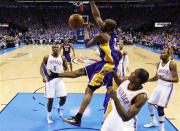 Los Angeles Lakers guard Kobe Bryant, center, dunks in front of Oklahoma City Thunder center Kendrick Perkins (5), forward Serge Ibaka, second from right, and forward Kevin Durant, right, in the second quarter of Game 5 in their NBA basketball Western Conference semifinal playoff series, Monday, May 21, 2012, in Oklahoma City. (AP Photo/Sue Ogrocki)