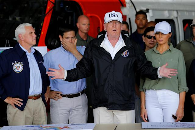 <p>President Donald Trump speaks between first lady Melania Trump and Vice President Mike Pence (L) and Senator Marco Rubio (R-FL) (2ndL) while receiving a briefing on Hurricane Irma relief efforts in Fort Myers, Fla., Sept. 14, 2017. (Photo: Jonathan Ernst/Reuters </p>