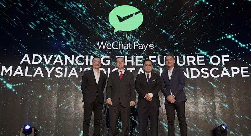 "(From left) Poshu Yeung, Vice President, International Business Group at Tencent, YB Tuan Lim Guan Eng, Minister of Finance of Malaysia, YB Tuan Chong Chieng Jen, Deputy Minister of Domestic Trade and Consumer Affairs, and Jason Siew, CEO, WeChat Pay MY, launching the first ever WeChat Pay MY Conference ""Advancing the Future of Malaysia Digital Landscape with WeChat Pay MY""."