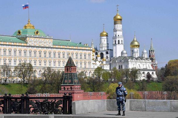 PHOTO: A member of the Russian National Guard stands guard on a bridge across the Moskva River, with the Kremlin seen in the background, in central Moscow on May 1, 2019. (Mladen Antonov/AFP/Getty Images, FILE)
