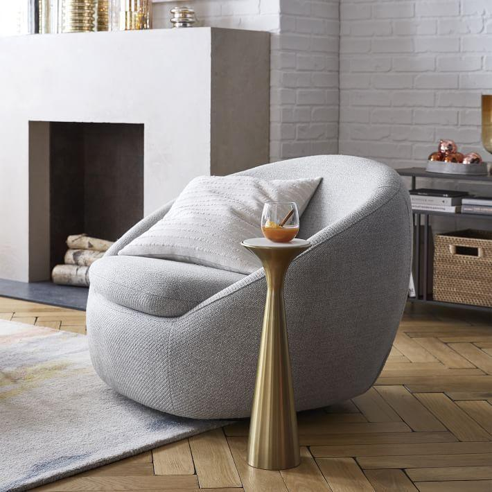 """<p>westelm.com</p><p><strong>$799.00</strong></p><p><a href=""""https://go.redirectingat.com?id=74968X1596630&url=https%3A%2F%2Fwww.westelm.com%2Fproducts%2Fcozy-swivel-chair-h3797&sref=https%3A%2F%2Fwww.thepioneerwoman.com%2Fhome-lifestyle%2Fdecorating-ideas%2Fg34848628%2Fcozy-chairs%2F"""" rel=""""nofollow noopener"""" target=""""_blank"""" data-ylk=""""slk:Shop Now"""" class=""""link rapid-noclick-resp"""">Shop Now</a></p><p>This cocoon-like chair is the perfect shape for curling up in. The swivel mechanism spins 360 degrees so you can easily move your focus between watching TV and the conversation in the room. </p>"""