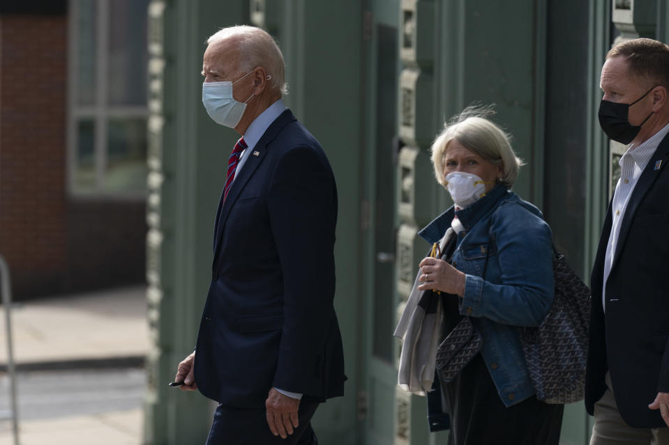 Democratic presidential candidate former Vice President Joe Biden and Anita Dunn center, depart The Queen theatre in Wilmington, Del., Monday, Oct. 19, 2020. (AP Photo/Carolyn Kaster)