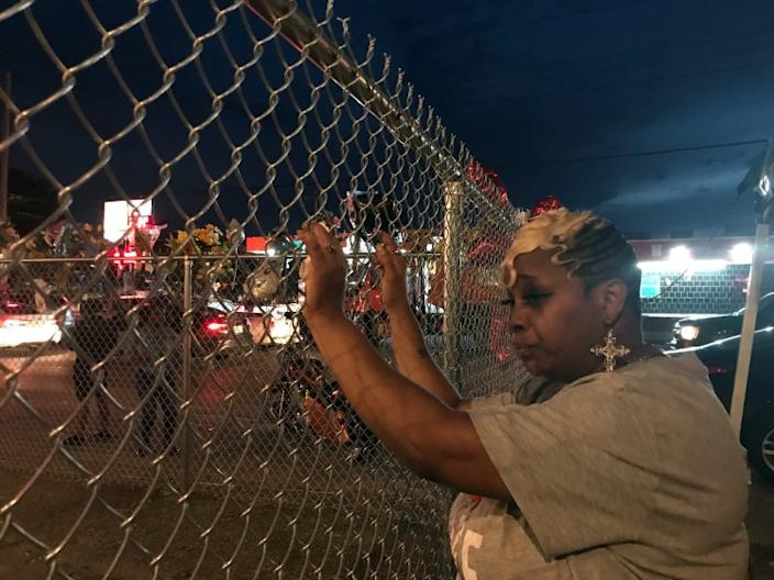 """Addie McAtee, 50, stands at the site where her brother, David McAtee, 53, was shot and killed by Louisville, Ky., police June 1. <span class=""""copyright"""">(Kate Linthicum/Los Angeles Times)</span>"""