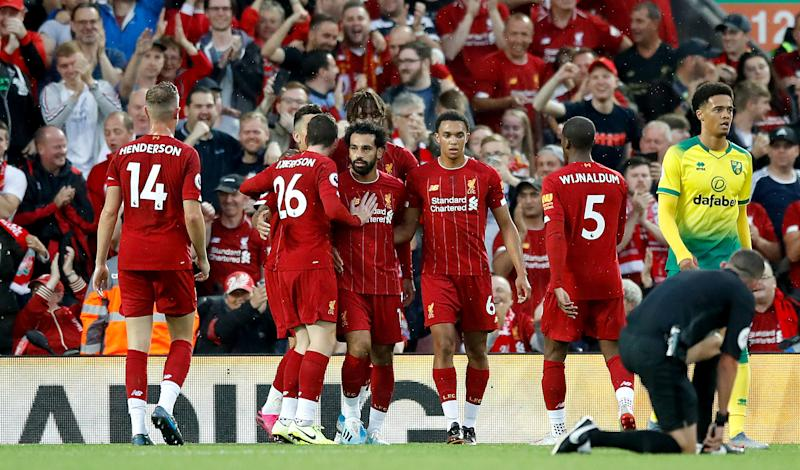 Liverpool's Mohamed Salah (centre) celebrates scoring his side's second goal of the game with his team-mates during the Premier League match at Anfield, Liverpool. (Photo by Martin Rickett/PA Images via Getty Images)