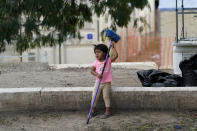A child plays at a camp for asylum seekers stuck at America's doorstep, in Matamoros, Mexico, Thursday, Nov. 19, 2020. Led by U.S. military veterans, Global Response Management is staffed by volunteers primarily from the U.S. and paid asylum seekers who were medical professionals in their homelands. The group has treated thousands of migrants over the past year at two clinics in Matamoros, including one inside the camp. (AP Photo/Eric Gay)