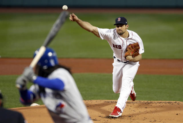 Boston Red Sox's Nathan Eovaldi delivers to a Toronto Blue Jays batter during the first inning of a baseball game Thursday, April 11, 2019, at Fenway Park in Boston. (AP Photo/Winslow Townson)