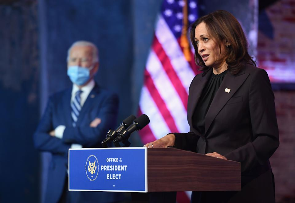 """US Vice President-elect Kamala Harris alongside US President-elect Joe Biden, delivers remarks at The Queen in Wilmington, Delaware, on November 10, 2020. - President-elect Joe Biden said November 10, 2020 he had told several world leaders that """"America is back"""" after his defeat of Donald Trump in last week's bitterly contested US election. (Photo by Angela Weiss / AFP) (Photo by ANGELA WEISS/AFP via Getty Images)"""