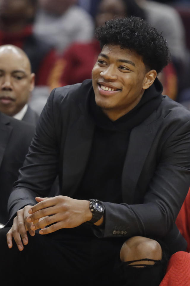 Washington Wizards' Rui Hachimura watches from the bench in the first half of an NBA basketball game against the Cleveland Cavaliers, Thursday, Jan. 23, 2020, in Cleveland. (AP Photo/Tony Dejak)