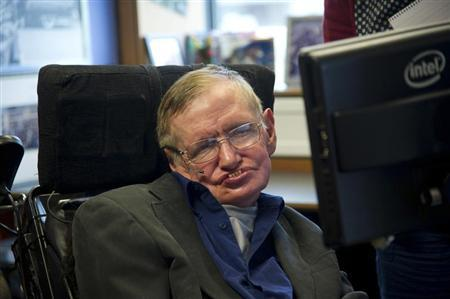 British physicist Stephen Hawking sits at his desk in the Applied Mathematics Department of Cambridge University