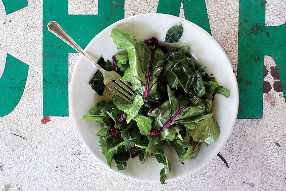 """Be on the lookout for collards with smaller, tender leaves. If using more mature bunches, cut into thin ribbons instead of tearing. <a href=""""https://www.bonappetit.com/recipe/hardy-greens-with-lemon-garlic-vinaigrette?mbid=synd_yahoo_rss"""" rel=""""nofollow noopener"""" target=""""_blank"""" data-ylk=""""slk:See recipe."""" class=""""link rapid-noclick-resp"""">See recipe.</a>"""