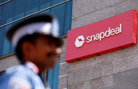 A private security gurad stands at a gate of Snapdeal headquarters in Gurugram