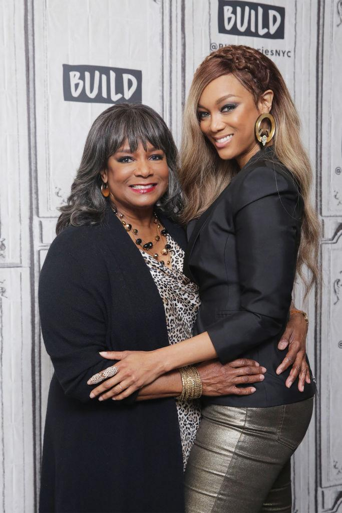 Tyra Banks and her mother, Carolyn London, strike a pose at the Build Studio in New York City. They're promoting their new book, <em>Perfect Is Boring</em>. (Photo: Getty Images)