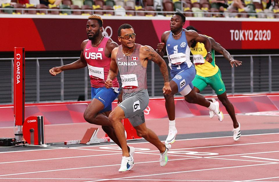 Andre de Grasse of Team Canada finishes ahead of Kenneth Bednarek of Team United States (Getty)