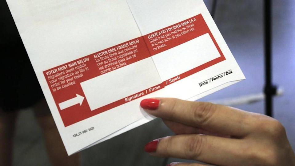 Voters must properly sign their name in the red box printed on the ballot envelope before mailing it to the supervisor of elections office or dropping it off. The Miami-Dade County Elections Department mailed more than 530,000 ballots on Oct. 1 to voters who requested them for the Nov. 3, 2020, general election.