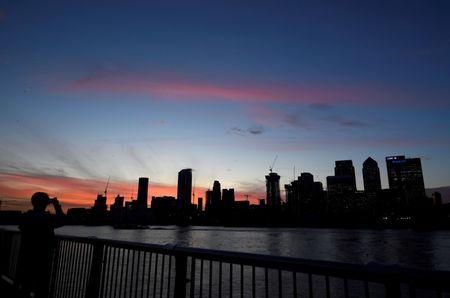 FILE PHOTO: The Canary Wharf financial district is seen at dusk in London, Britain, November 17, 2017.  REUTERS/Toby Melville/File Photo